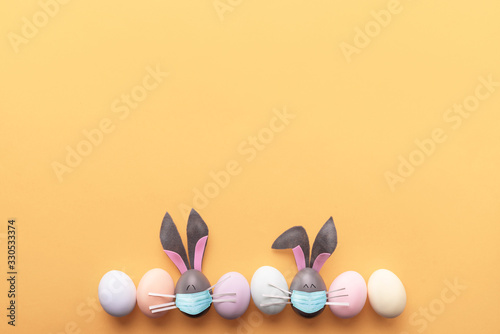 Cute creative photo with easter eggs, some eggs like easter bunny Wallpaper Mural