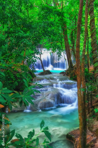 The beautiful Erawan cascade waterfall with turquoise water like heaven and sunlight at the tropical forest ,Kanchanaburi National Park, Thailand