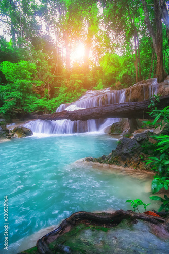 The beautiful Erawan cascade waterfall with turquoise water like heaven and sunlight at the tropical forest ,Kanchanaburi National Park, Thailand - 330537964