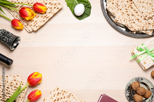 Obraz Flat lay composition with symbolic Pesach (Passover Seder) items on wooden table, space for text - fototapety do salonu