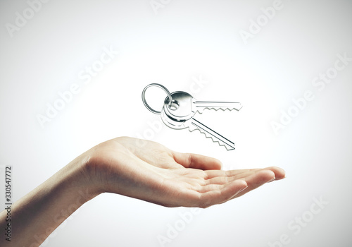 Cuadros en Lienzo Hand holding key to new house