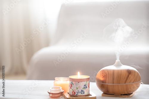 Fototapeta Modern oil aroma diffuser in the living room on the table . obraz