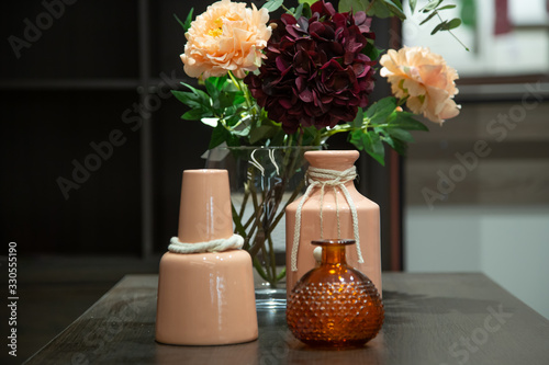 Obraz Decorative items in the interior, a Beautiful vase on the table. - fototapety do salonu