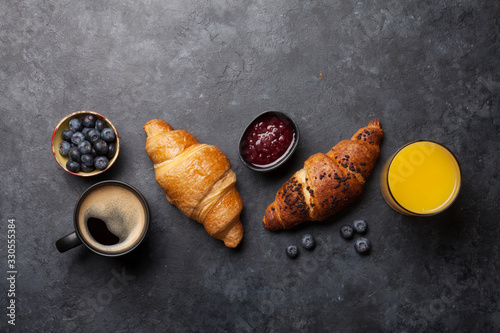 Fototapeta Breakfast with coffee and croissant obraz