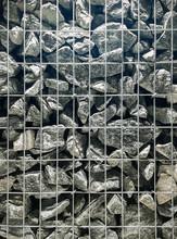 Wall Of Stone Behind Bars.