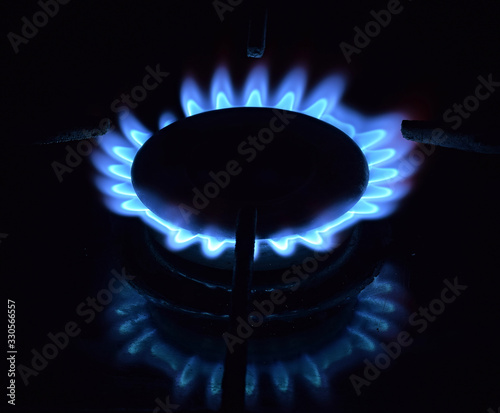 The blue flame of the gas stove. Fragment. Close up.