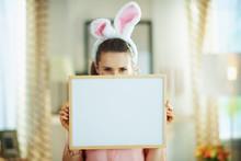 Happy Modern Female Hiding Behind Blank White Billboard