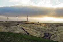 Three  Wind Turbines Under A C...