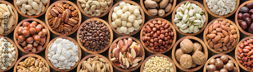 assorted nuts background, vegetarian food in wooden bowls, top view Poster Mural XXL
