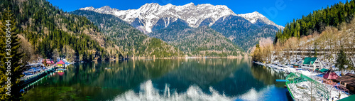 Lake Ritsa in the Caucasus Mountains, in the north-western part of Abkhazia, surrounded by mixed mountain forests and subalpine meadows Canvas Print