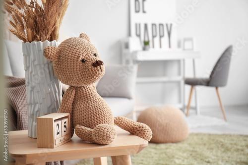 Obraz Cuddly toy on table in room - fototapety do salonu