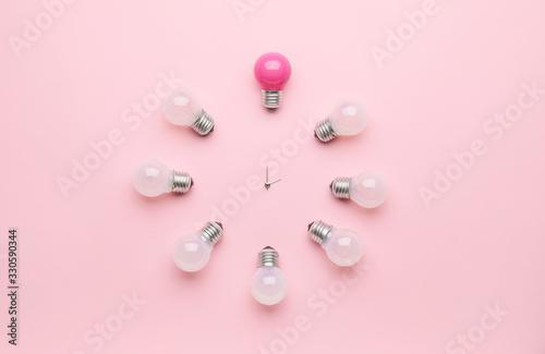 Obraz Creative clock made of light bulbs on color background - fototapety do salonu