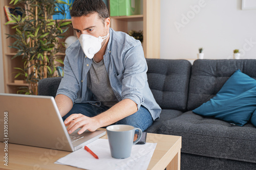 obraz PCV Man teleworking from home after coronavirus pandemic