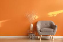 Comfortable Armchair Near Color Wall