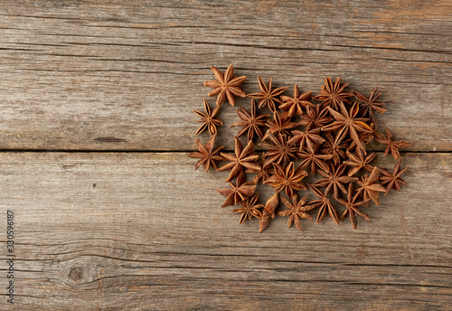 fragrant anise star anise on a gray wooden background from boards, top view Canvas Print