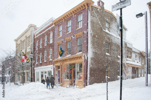 Annapolis street scene of shops during blizzard with snow falling heavily Wallpaper Mural