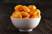 Bowl Of Cheddar Cheese Curds O...