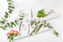 Bottles Of Different Essential Oils On White Background