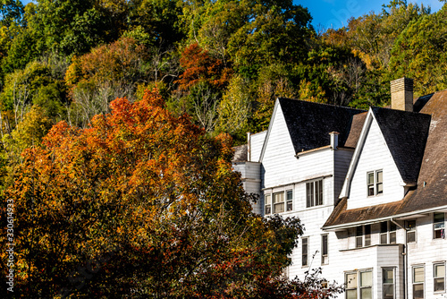 Hot Springs, VA historic downtown town village city in Virginia countryside closeup of autumn orange tree and old building architecture