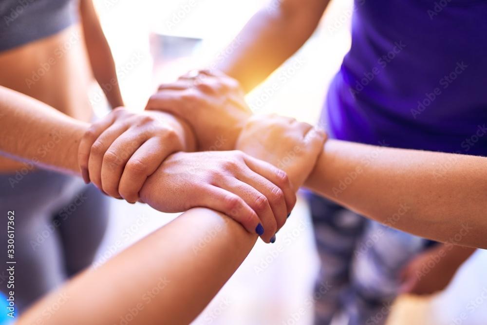 Fototapeta Young beautiful sportwomen doing gesture with hands