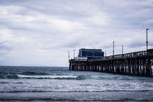 Ocean Waves Crashing Under A Pier