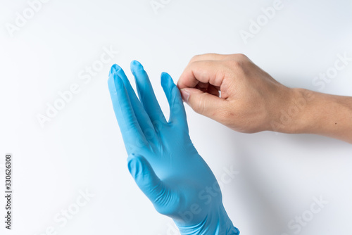 Photographie Hands are wearing nitrile gloves