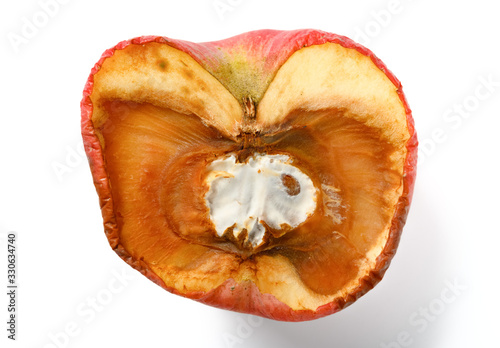 Valokuvatapetti top view overripe apple with rotten core on white background