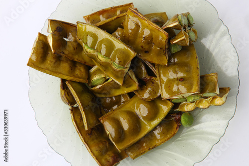 Fried Stinky Bean/petai which is served with sliced Fototapet