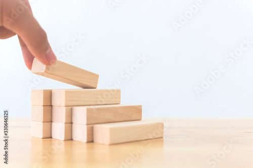 Fotografie, Tablou Hand arranging wood block stacking as step stair