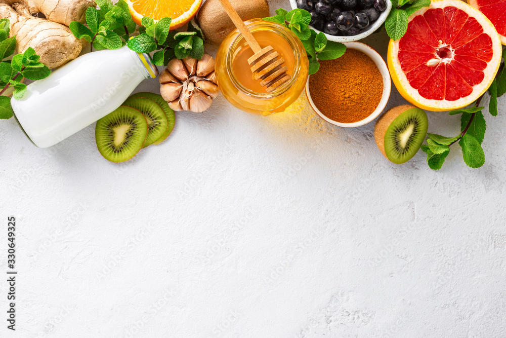 Fototapeta Set vegetables and fruits to boost immune system. Healthy products for Immunity boosting top view. Copy space