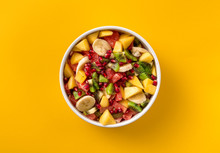 Mixed Fruit Salad In Plate On Yellow Background Top View Diet Summer Food Concept