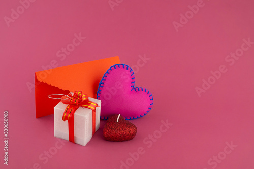 Romantic still life with heart, gifts and envelope