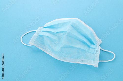 Fototapety, obrazy: Disposable mask on blue background