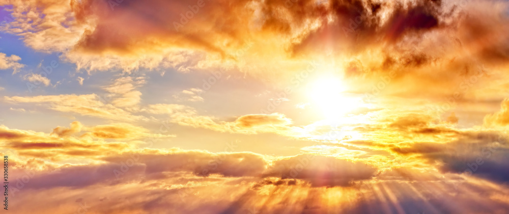 Fototapeta dramatic sunset sky landscape background natural color of evening cloudscape panorama with setting sun rays highlighting clouds ultra wide panoramic view