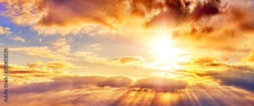 fototapeta na lodówkę dramatic sunset sky landscape background natural color of evening cloudscape panorama with setting sun rays highlighting clouds ultra wide panoramic view