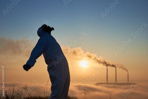 Fototapeta Side view of scientist in gas mask
