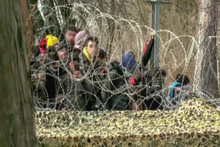 Abstract, Blurry, Out Of Focus Image For Media And Internetа. A Group Of Unorganized People Are Trying To Illegally Cross The Border.