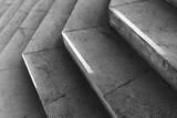 Fototapeta Na drzwi - Empty dark gray stone stairs with sunlight over it