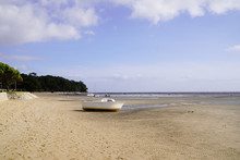 Small Boat In Sand Beach At Lo...