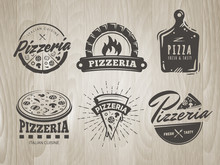 Pizza Logos. Set Of Pizzeria Badges With Whole Pizzas And Slices. Labels For Trattoria, Pizzeria, Italian Cuisine Restaurant Of Cafe On Vintage Wooden Background