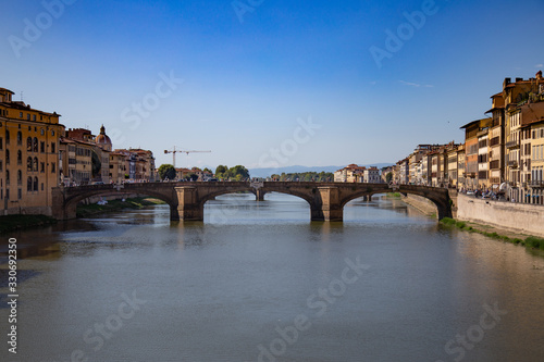 FLORENCE, ITALY - September, 2019: Italian traditional houses and architecture over Arno river with blue sky in Florence, Italy Canvas Print
