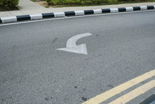 Road Turn Signs Painted On The...
