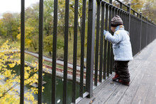 On The Bridge A Small Child Lo...