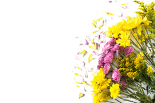 Bouquet Of Yellow And Violet Spring Flowers Isolated On White Background. Top View. Copy Space
