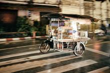 Thai Street Food Vendor Riding...