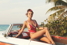 Sexy Woman In Red Swimsuit And Retro Cabriolet Car
