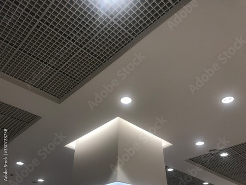 Photo Suspended Grid false ceiling with gypsum bulkhead design and column coves with