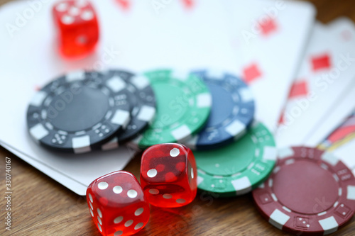 obraz PCV Red dices lying with casino chips as gambling symbol
