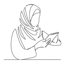 Muslim Woman Working On A Tablet