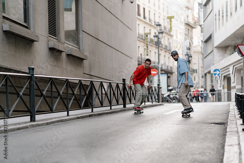 Men Skateboarding In The City
